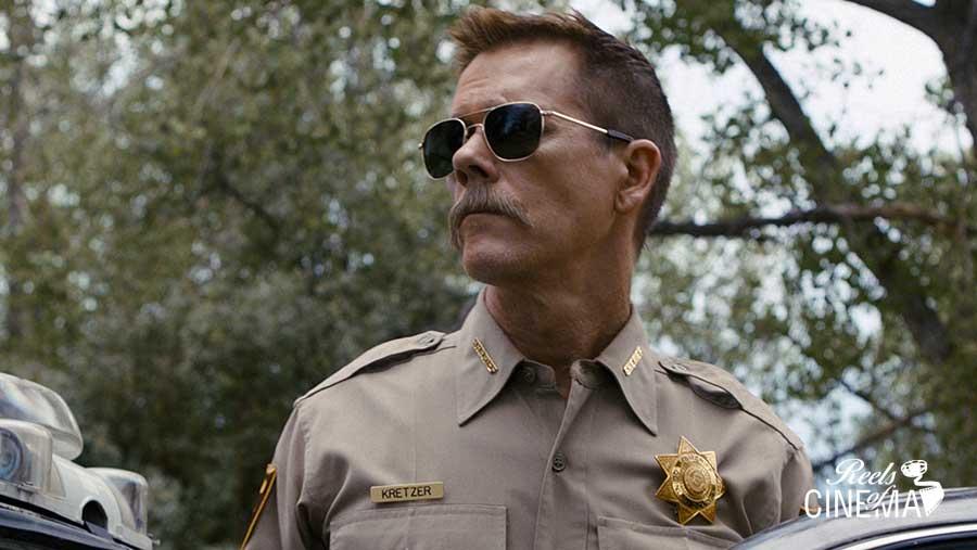 Kevin Bacon en Coche policial